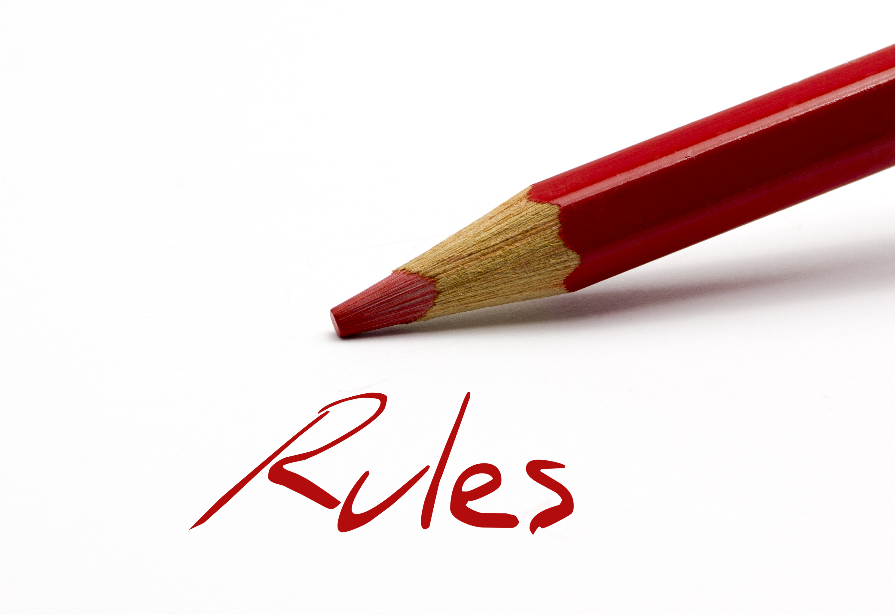 "red pencil with the word ""Rules"""