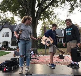 2 teen music band members and a roadie