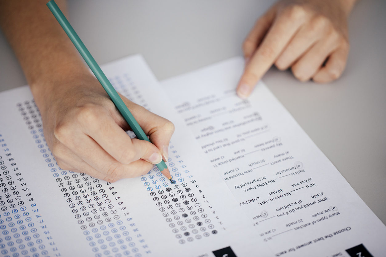 Student hands taking a test